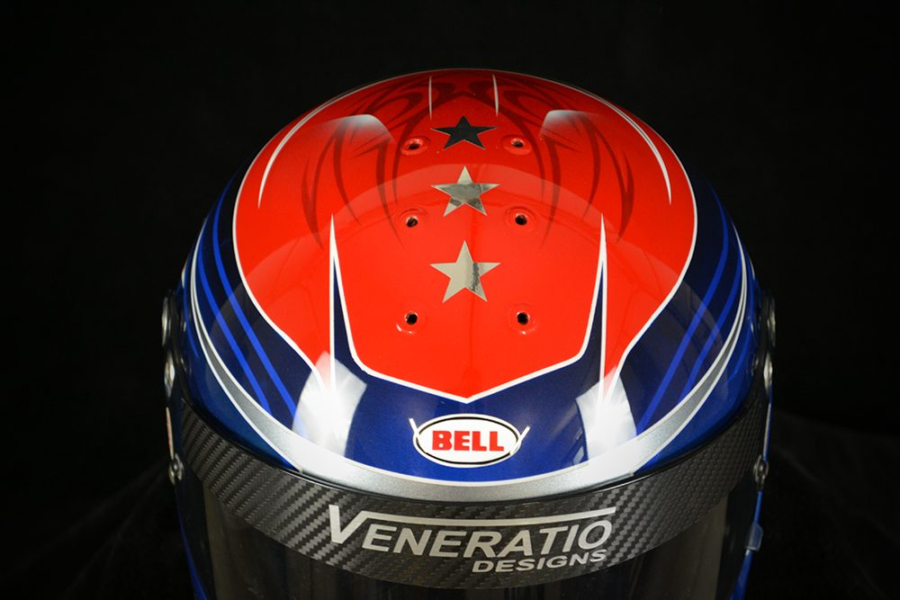 Custom painted Bell GP2. Tribal pattern and stars with red, blue, and black. Custom helmet painting by Veneratio Designs.