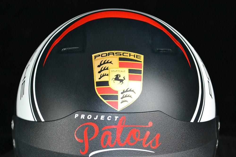 Porsche racing open face helmet with matte finish and red Antman Custom Trix. Custom helmet painting by Veneratio Designs.