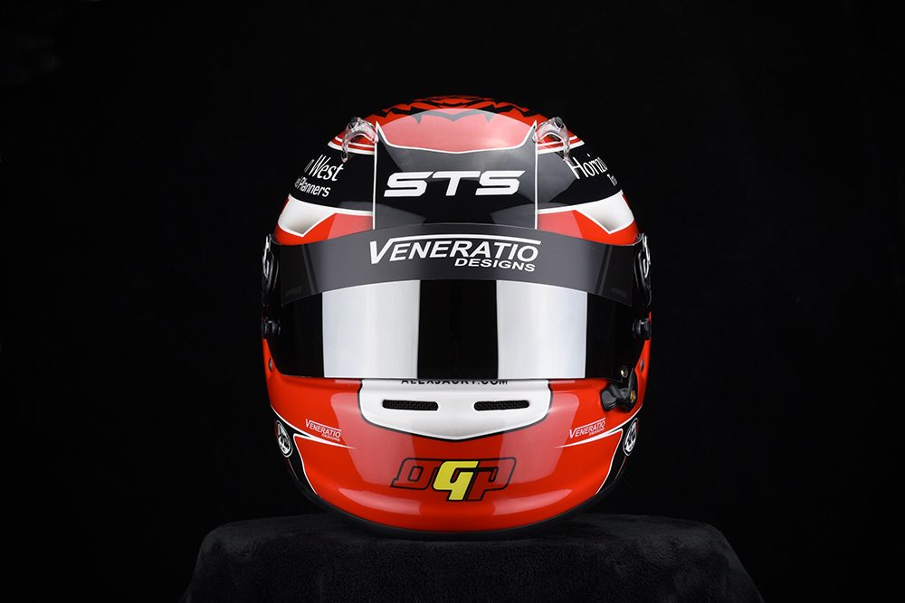 Custom painted racing helmets by Veneratio Designs.