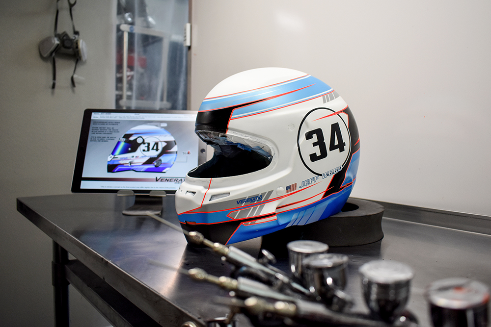 Custom racing helmets by Veneratio Designs